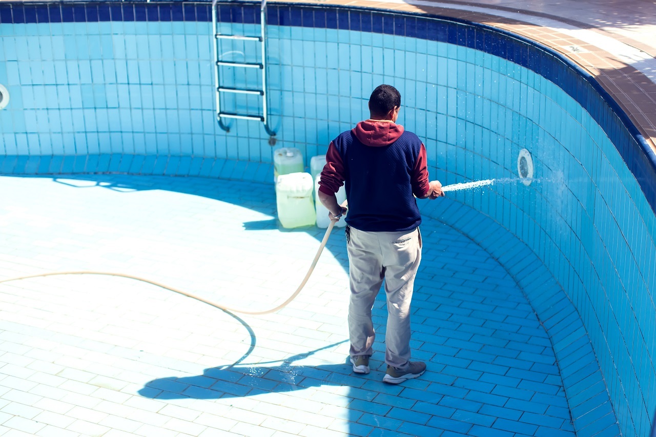 Service-and-maintenance-of-the-pool.-Man-cleans-the-pool