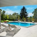 beautiful-house-swimming-pool-view-from-the-veranda-summer-day
