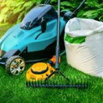 gardening-tools-and-lawn-care-equipment-on-green-grass